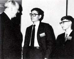 Secretary Rusk, with two students from Georgia